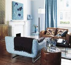 Brown Leather Sofa Living Room Ideas by Light Blue And Brown Living Room With Blue Armchair And Brown Sofa