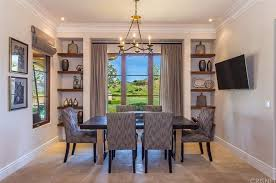 The Dining Room Offers An Elegant Table Set Along With A Chandelier
