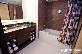 bathroom at the two bedroom suite 1 at the elara a hilton grand