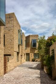 100 Mews Houses Peter Barber Architects Uses Oriel Windows To Animate The