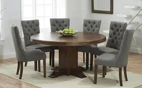 Oval And Round Dark Wood Dining Table Sets