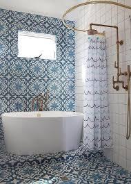 exquisite mediterranean themed bathroom is clad in cement tile