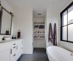 white shiplap bathroom with gray slate herringbone floor tiles