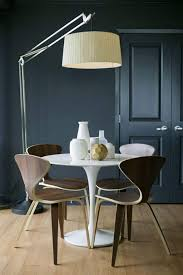 Dining Room With Contemporary Furniture And Floor Lamp