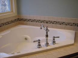 white bathroom tiles with blue mosaic border this is how we used