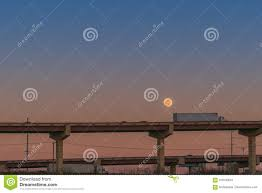 Semi Truck 18 Wheeler On Bridge Overpass With Moon Stock Image ...