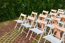 White Wooden Chairs Decorated With Orange Bows And Roses For.. Stretch Cover Wedding Decoration For Folding Chair Party Set For Or Another Catered Event Dinner Beautiful Ceremony White Wooden Chairs Details About Spandex Chair Covers Stretchable Fitted Tight Decorations 80 Best Stocks Of Decorate Home Design Hot Item 6piece Ding By Mainstays Patio Table Umbrella Outdoor Amazoncom Doll Beach Lounger Dollhouse Interior Decorated With Design Fniture Folding Chair Padded Chairs Round Tables White Roof Hfftlh Adjustable Padded Headrest Black Flocking Cover Tradeshow Eucalyptus Branch Natural Aisle