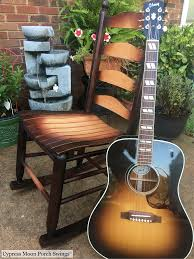 A Beautiful Armless Rocking Chair And Guitar! This Wonderful Photo ... Greendale Home Fashions Cream Hyatt Jumbo Rocking Chair Cushion Set Vintage Sgarsul Rocking Chair For Poltronova In Leather And Curved Massive Wood Custom Redwood Rockers Peglev Rocker Pad Pads And Cushions Jefferson Cherry Colour Tyson Chairs Patio The Depot Hutchcraft Slat