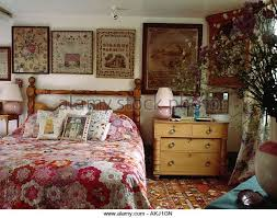 English Cottage Bedroom With Antique Samplers And Pretty Patchwork Quilt