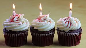 Three Chocolate Birthday Cupcakes With e Burning White Candle In Each HD Stock Footage Video