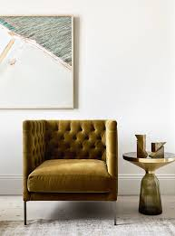 Crate And Barrel Petrie Sofa Look Alike by Vintage Gold Velvet Tufted Chair In The Living Room A