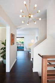 sputnik light entry midcentury with banister baseboard ceiling