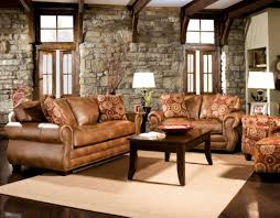 Rustic Living Room With Stone Wall Idea Plus Black Coffee Table And Beautiful Brown Leather Sofa