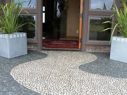 Pebble Stone Flooring For The Attractive And Innovative Installed At Terrace