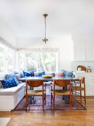 Big White Kitchen Banquette Gray Square Dining Table Brown Wooden Chairs Madium Wood Flooring Blue Pink Cushion Red Floral Rug Glass Globe Pendant Light