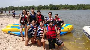 Image may contain 8 people people smiling people standing outdoor water