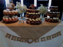 Rustic Wedding Dessert Table With Burlap Linens Wood Slices And Babys Breath By Its Personal