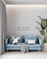 modernes wohnzimmer wandmodell mit blauem sofa und kissen