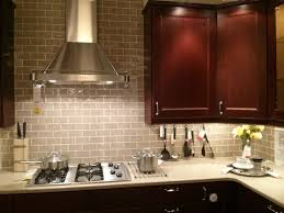 interior glass subway tile backsplash with stainless steel
