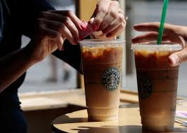 89988724 Couple Has Iced Coffee Drinks At A
