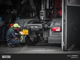 Truck Service Technician Job. Image & Photo | Bigstock Lionel Semitractor And Piggyback Trailer Semi Truck Repair Towing And Family Owned Fleet Repair In Alburque Nm Asecertified Heavy Sales Service Roadside New Trailers Leasing Parts Daimler Unveils Vision One Electric Free Images Traffic Car Motor Vehicle Emergency Service 3m Reflective Vinyl Decal Package For Maggios Out Volvo Orlando Tire Wheels Tires Gallery Pinterest National Commercial