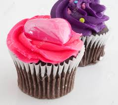 Chocolate cupcakes on white with pink and purple frosting Stock