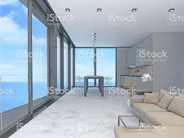 wohnzimmer und küche mit fenster und blick auf meer stockfoto und mehr bilder abwesenheit