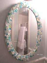 mirror in small bathroom is a diy with sea glass crystals and