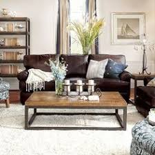 Brown Furniture Living Room Ideas by How To Visually Lighten Up Dark Leather Furniture Dimples