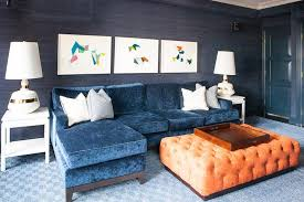 blue velvet sofa with chaise lounge with orange tufted ottoman