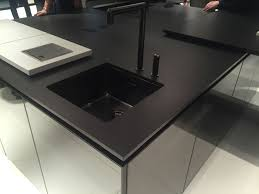 Kitchen Sink Drama Features by Drama And Elegance Reflected In A Black Kitchen Countertop