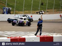 A Race Official Waves The Chequered Flag During Racing At Auto Clearing Motor Speedway