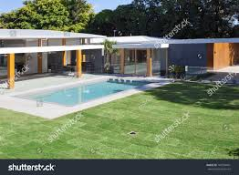 Modern Backyard Swimming Pool Australian Mansion Stock Photo ... Good News This Mansion With An Unreal Private Backyard Water Deluxe Cedar Kids Playhouse Discovery 32m Texas Mansion Has Waterpark Inground Trampoline In Backyard Rachel Ben And Their Perfect New England Diy Wedding Impressive Indian Village With A Pool Sells For Above Grey Gardens Sale The Resurrection Of Big Edie Beales Victorian Playsets Boca Raton 37foot Waterfall Lists 13m Curbed Abandoned The Documentation Center Creative Small Pool Designs Waterfall Multilevel Design Awesome House Fire Pit Description From