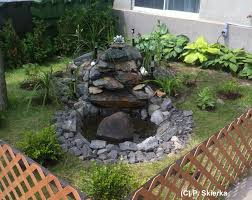 Garden With Fountain In An Underprivileged Neighborhood - Journal ... Backyard Fountains Ideas That Asked You To Mount The Luxury As 25 Gorgeous Garden On Pinterest Stone Garden 34 For A Small Water Fountains Unique Pondless Flak S Water Front Yard And Backyard Designs Outdoor Patio Fountain Ideas Patios Home Decorating Features For Any Budget Diy Diy Outdoor Wall Amazing Landscape Delightful Edible Design F Best Pictures Of The Ipirations