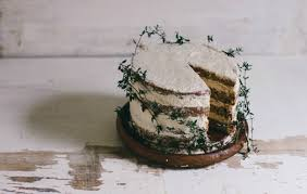 A Rustic Naked Wedding Cake Entwined With Thyme Sprigs For Winter