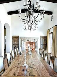 Rustic Elegant Chandelier French Dining Room Features A Long Plank Table Lined With Linen