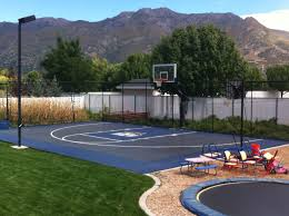 This Pro Dunk Diamond Basketball System Sits Next The Backyard ... Multisport Backyard Court System Synlawn Photo Gallery Basketball Surfaces Las Vegas Nv Bench At Base Of Court Outside Transformation In The Name Sketball How To Make A Diy Triyaecom Asphalt In Various Design Home Southern California Dimeions Design And Ideas House Bar And Grill College Park Half With Hill
