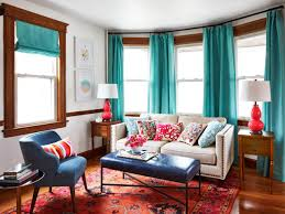 Wood Paneled Living Room With Turquoise Curtains And Navy Leather Bench