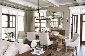 Farmhouse Dining Room Chandelier Traditional With Door Casing Upholstered Chairs French Doors
