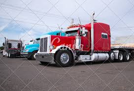 100 Simi Trucks Big Rig Semi Trucks Stand In Row On Parking Lot Photos By