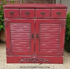 Maple Cabinet With Louvered Doors In Barn Red Black Glaze Ornate Wood Applique Added