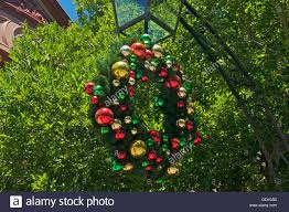 Driftwood Christmas Trees Sydney by Christmas Wreath With Colourful Decorations Hanging From A Lamp