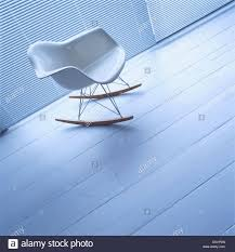 Close-up Of White Charles Eames Rocking Chair On Wooden ... Eames Dsw Fiberglass Chair Raw Umber Maple Vintage Rar Fiberglass Rocking Chair By Charles Ray For Herman Miller 1980s Design Market Vitra Lounge Ottoman Beauty Versions Walnut With White Pigmentation Clay 89 Cm Alinium Polished Seat Padfelt Pad Plastic Arm Chairs Dar Daw Dax Hey Sign Headline Swivel 8 Hottest Scdinavian To Get Your Interior Space Pp Light Choco Designers Tips Comfort The Table Looking The Rocking In Turquoise Sale Usedsolid Wood Ding Fniture Replica Diiiz