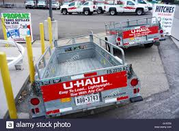 U-Haul Rental Trailers For Do-it-yourself Hauling And Road Stock ... Uhaul Rental Moving Trucks And Trailer Stock Video Footage Videoblocks U Haul Truck Review Moving Rental How To 14 Box Van Ford Pod To Drive A With An Auto Transport Insider The Cap Stop Inc Online Rentals Pickup Frequently Asked Questions About Uhaul Brampton Trucks For Sale In Buffalo Ny Comparison Of National Companies Prices Enterprise Locations Best Resource Neighborhood Dealer Lancaster California Tavares Fl At Out O Space Storage Coupons For Cheap Truck