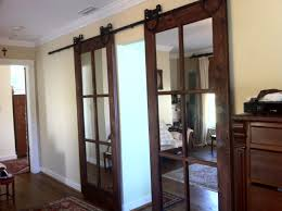 We Currently Have A Standard French Door Between The Kitchen And ... Beautiful Built In Ertainment Center With Barn Doors To Hide Best 25 White Ideas On Pinterest Barn Wood Signs Barnwood Interior 20 Home Offices With Sliding Doors For Closets Exterior Door Hdware Screen Diy Learn How Make Your Own Sliding All I Did Was Buy A Double Closet Tables Door Old