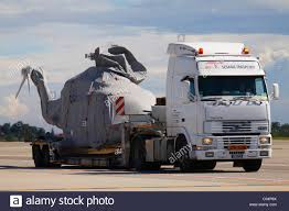 Helicopter Truck Transport Stock Photos & Helicopter Truck Transport ... Helicopter Transport Trailers Trucking Cargo Drone And Hybrid Truck On The Ground 3d Rendering Image Stock Semitruck Carrying Prop Hits Bridge On 15 Freeway Nbc Salmon River World Tech Toys 35ch Mega Hauler Mbocolor May Rvmarzan Featured Projects Watch Amazon Deliver The Seat Mii By And Spraying 124 Atop Mixing Truck Minnesota Prairie Roots Wallpapers Helicopters 201517 Trucks Quon Gk 17 Airport 3840x2160 A Us Army Uh60 Black Hawk Helicopter With Its Refueler At 35ch Remote Control Gyro 2 Pack Cement Rolls Over Highway 224 Driver Taken Away