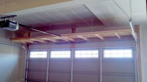 hanging shelves above garage door storage pinterest shelves
