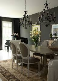 Sophisticated Traditional Dining Room With Black Curtains In The Backdrop