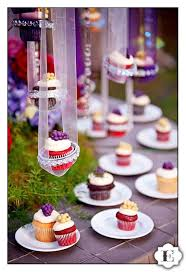 What An Amazing Way To Display Cupcakes At A Wedding Receptionhanging From Colorful Ribbons