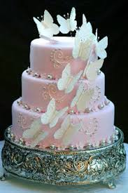 Three Tier Pink Wedding Cake With Handmade Beautiful White Butterflies As The Topper Cascading Down To Lower Decorated Small And Large